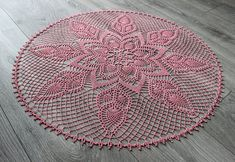 Large round crochet doily in light pink. Made with quality mercerized crochet cotton. Starched for stiffness and shape. 69cm (27) in diameter. I have a variety of crochet doilies available for sale- please see my other items. All crochet doilies that I sell are new and have been hand