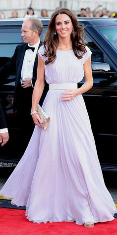 Catherine in a lilac Alexander McQueen creation, Jimmy Choo sandals and clutch, and earrings borrowed from the Queen.