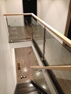 Banister for open stairs; glass railing. Glass wall.