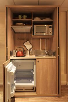 concealed appliances, tea and coffee stations Hidden Kitchen, Mini Kitchen, Kitchen Units, Little Kitchen, Kitchen Small, Kitchen Tools, Kitchen Appliance Storage, Kitchen Appliances, Kitchen Utensils