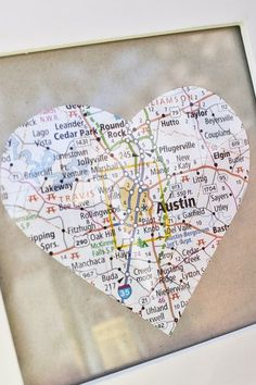 Find the honeymoon spot on a map, cut out & put it in a frame <3