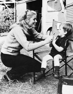 Catherine Deneuve and her son Christian on the set of A Matter of Resistance, 1965.