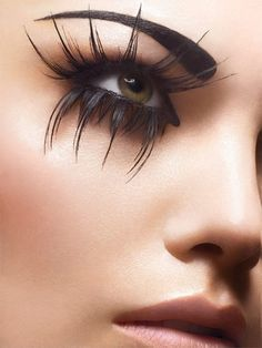 Crazy #Eyemakeup with crazy False eyelashes and a super defined eyebrow it almost looks tattooed to be that perfect. #FalseLashes both on the top and bottom lashes of these #almondeyes.