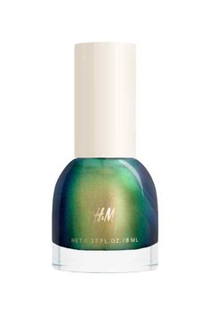 Bring out your inner mermaid with this metallic green + gold nail polish.