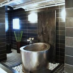 Japanese Soaking Tub in Elegant Black and Grey Bathroom