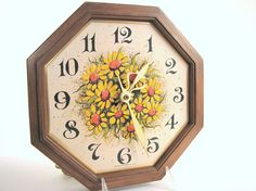 This vintage 1970s, Spartus, electric kitchen wall clock has a beautiful bouquet of daisies on the octagonal face.