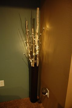 Floor vase with birch, branches, and lighted branches on a 6 hour timer.