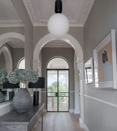 Victorian hallway with period detail and new arched steel door Victorian Hallway, Victorian Decor, Steel Doors, Villa, Ceiling Lights, Contemporary, Mirror, Lighting, Period