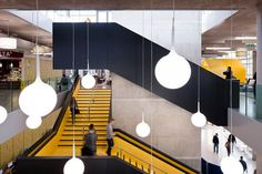 nice YELLOW stair & lighting; nice contrast with the concrete and black