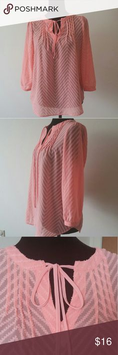 ELLE Peach Long Sleeve Tunic/Blouse Size XS Absolutely stunning peach tunic by ELLE. ??% Polyester. Worn just a couple times, in excellent condition!!! Size XS, but will perfect for S as well. Elle Tops Tunics