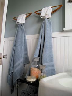In the upstairs bathroom, I repurposed two old wooden hangers as towel bars. By anchoring a scrap piece of dowel to the wall before the hanger was attached with 2 screws, I created a simple, yet sturdy place to hang a towel! Bathroom Towel Hooks, Bathroom Storage, Bathroom Ideas, Anchor Bathroom, Wooden Bathroom, Kmart Bathroom, Disney Bathroom, Paris Bathroom, 1950s Bathroom