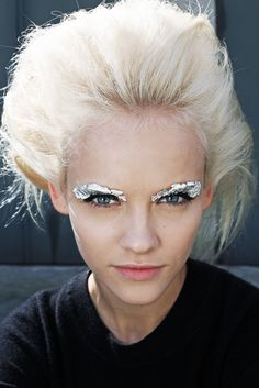 tinfoil AND EYELASH GLUE.. i'll have to remember this for halloween.. all over face.. or body.. that'd be rad