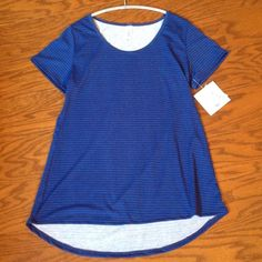 LuLaRoe Striped Classic Tee Brand new. Navy blue and a brighter blue stripes. LuLaRoe Tops Tees - Short Sleeve