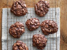 cookies are airy and crisp on the outside and gooey on the inside, like a brownie in cookie form. If that wasn't enough, each cookie is filled with toasted chopped pecans and gooey pockets of melted chocolate. The recipe calls for four ounces of semisweet chocolate, chopped