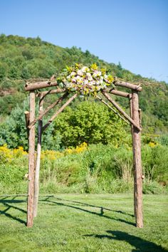 Wooden arch with a beautiful cluster of flowers. Photography: Kelly Dillon Photography - www.kellydillonphoto.com