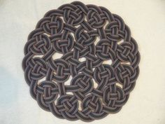 Handwoven Rug Made from Recycled Climbing Rope - 27 inch diameter.. $75.00, via Etsy.