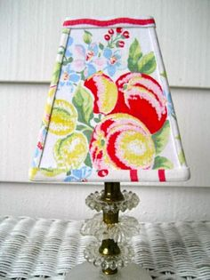 vintage tablecloth lampshade...what a wonderful idea! (sassy shades via etsy)