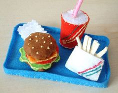 How to make felt hamburger 1. Looking for a size suitable piece from the scraps. 2. Cut felt. Sew along the edges with overhand stitch to make leaf、tomato slice、 cheese、hamburger. 3. Overlap them a…