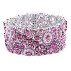 Dazzling bracelet from the Miadora Luxe Collection features pink tourmaline and sapphire gemstones set in 14-karat white gold. This beautiful piece is dotted with 1 carat of gleaming diamonds and is set in 14-karat white gold. $16,999.99