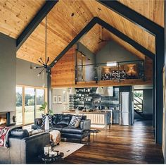 Open industrial Loft, vaulted ceilings, and wide open Open industrial Loft, vaulted ceilings, and wide open Vaulted Ceiling Bedroom, Vaulted Ceiling Kitchen, Vaulted Ceiling Lighting, Vaulted Ceilings, Modern Barn House, Barn House Plans, Modern Houses, Metal Building Homes, Building A House