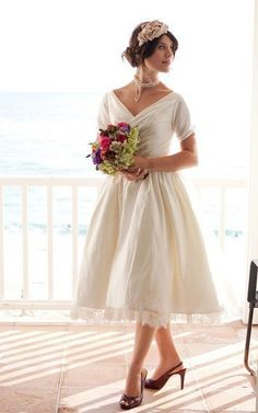 A full gathered skirt dress with v-neck and 3/4-length   sleeves design. Lace trimmed taffeta skirt. Free made-to-measurement service for any size. Available colors seen as in Color Options.