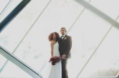 HUGE Thank you to Every Last Detail, Chaz Cruz Photography, Swann Soirées, Rae Florae, Root Cellar Catering Co., Natty Macs, The New Children's Museum, www.jeweliany.com, and Simply Bridal for coming together to make this photoshoot a success!  Modern Red Industrial Wedding Inspiration: by Lauren Grove  Groom in our Three-Piece Brown Suit; http://www.abetterdealtuxedo.com
