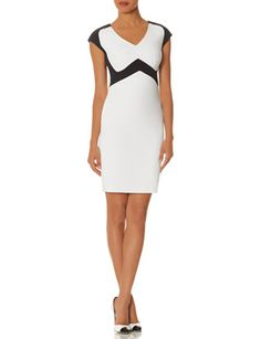 "Black & White Sheath Dress from THELIMITED.com  Elegant and confident, The Limited collection inspired by SCANDAL embodies the aesthetic of Olivia Pope for real-life Gladiators and everyday fashionistas. Elevated fabrics and details have a luxurious look and feel for powerfully sophisticated styling! Rich colorblocked woven Invisible back zipper with hook and eye closure Inner ribbon trim, fully lined From shoulder to hem: Petite= 37"", Regular= 39"", Long/Tall= 40"""