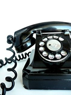 Vintage telephone, from the 50s  before that there was no curly cord. Just cord like on an iron.