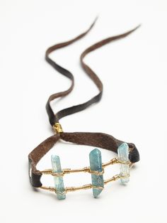 Take Flight Bun Cuff   Dress up your top knot or messy bun with this ethereal triple clear quartz crystal bun cuff.  Adjustable leather strap and brass hardware.  American made.