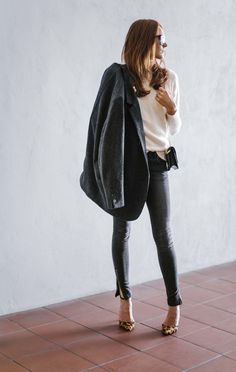 Leopard pumps and dark gray jeans