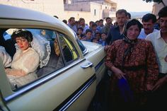 Photo by @edkashi / @viiphoto. A nervous Kurdish bride sits in the car in Afrin, Syria on May 1, 1991. At Kurdish weddings, even their terms of divorce are pre-arranged. #kurds #Syria #marriage #wedding #crowd #party #bride #tbt #travel #onassignment #ontheroad #fromthearchives #edkashi #viiphoto