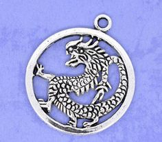4 Silver Tone Dragon Charm Circle Charm Pendants by SmartParts, $2.19