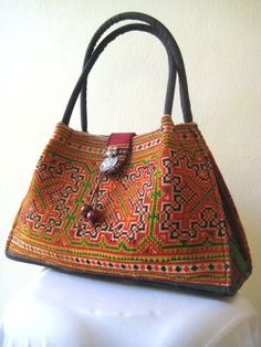 Love this Hmong bag that an artisan made by using the vintage textile and making a useful modern purse.