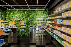jose levy vivifies MaPharmacie drugstore in paris with colorful tiles and green plant wall