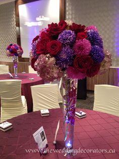 Large purple flower centrepieces.  Purple wedding decor.