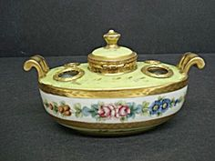 LUXURIOUS ANTIQUE INKWELL, MADE AND SIGNED IN FRANCE. iT IS COMPLETE WITH INK LINER AND HINGED LID. HAND PAINTED FLORAL