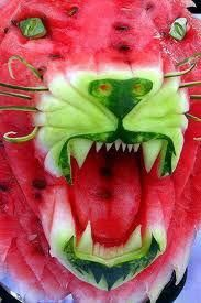For my next Ky. Wildcats Party :A watermelon carved into a growling wildcat. Impressive. (via Irish Examiner Food Fest)