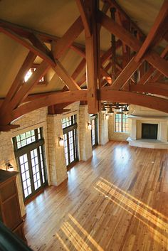 metal building houses French doors, hardwood, and a great fireplace. And those trusses! Pole Barn House Plans, Pole Barn Homes, Timber Frame Homes, Timber House, Timber Frames, Roof Truss Design, French Style Homes, A Frame Cabin, Metal Building Homes