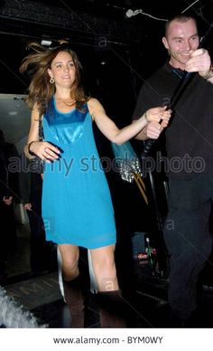 5/3/07 - Kate was ushered outside the front door with help past the many paparazzi camped out outside.