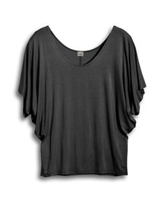 Plus size top features scoop neckline with three quarter dolman sleeves. Lightweight stretchy jersey knit. Relaxed fit. Available in junior plus size 1XL, 2XL, 3XL.