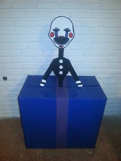 Justin's fnaf birthday party puppet decoration.