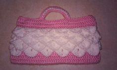 Crocheted handbag with pearl beaded handle