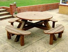 This Round Picnic Table Seats Up To People Comfortably On Its - 8 seater round picnic table