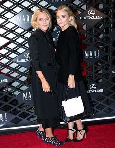 Ashley and Mary-Kate Olsen both dressed in fashionable black for the Lexus Design Disrupted event.