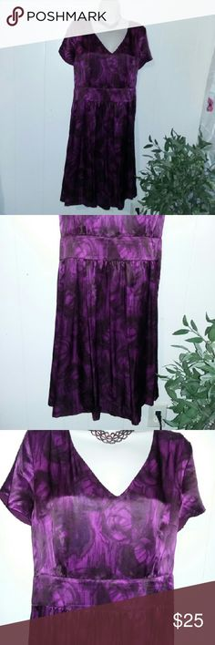 Banana Republic 100% Silk Dress EUC NICE Beautiful dress by Banana Republic size 16. The material is 100% silk and it does have a lining. The color is magenta purplish color I'm kind of bad with exact colors. It is short sleeve it's kind of of fit and flare it does have a waistband but it's not elastic at all. It zips in the back. Excellent condition I find no defects. Please message with any questions. Banana Republic Dresses