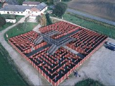 From Labyrinthia in Denmark, the panel maze uses bridges to break up what would otherwise be a Roman design. Nice.