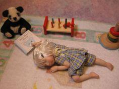 Miniature sleeping toddler