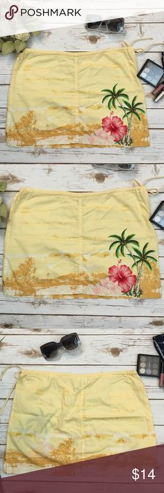 🌺Hawaiian Mini Skirt🌺 Hawaiian mini skirt. Beautiful flower and palm tree details.  Draw string waist with a little pocket in the back.  100% Cotton  🚫 NO TRADES 🌟 POSH Rules Only 🌟 🎉 Customized Bundle Discounts 💋 💗 Offers please use offer button below 🔻 Tilt Skirts Mini