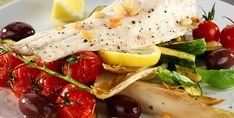 Roast Sea Bass with Baby Courgettes - Napolina Recipe.