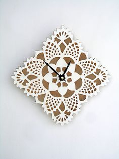 White square doily clock, lasercut wood. $32 from uncommon.